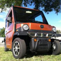 front of orange revolution golf car